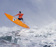 Tyler Fox flies out of a wave during the second heat of the first round of the Mavericks Invitational big wave surf contest Friday, Jan. 24, 2014, in Half Moon Bay, Calif. (AP Photo/Eric Risberg)